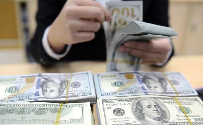 Hạ lãi suất Mỹ kim, tỉ giá tăng lên nhanh chóng