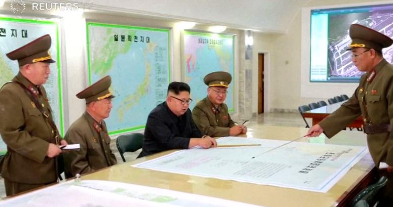Kim Jong-Un quyết định hoãn bắn thử 4 hỏa tiễn tới Guam, chờ hành động kế tiếp của Mỹ