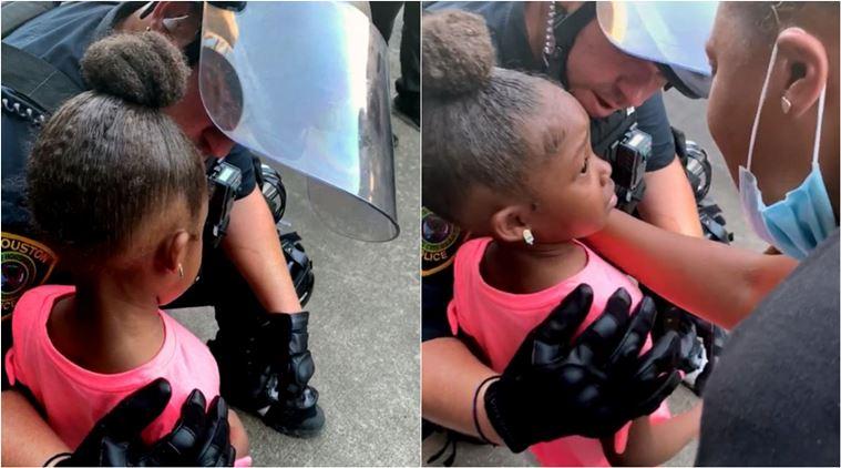 Cảnh sát ở Houston trấn an một bé gái 5 tuổikhi đượcliệu cảnh sát có bắn gia đình cô bé trong cuộc biểu tình George Floyd